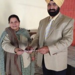 Principal Beantjit Kaur (Punjab College Of Education Chunni Kalan) Presenting Award to Mr.Dilbag Singh Goarya